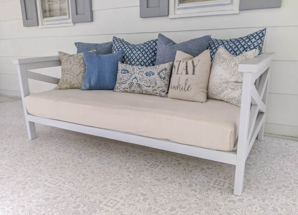 completed daybed with mattress in linen cover and blue and tan pillows