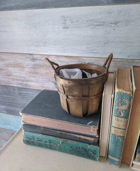 basket on table in entryway for used face masks