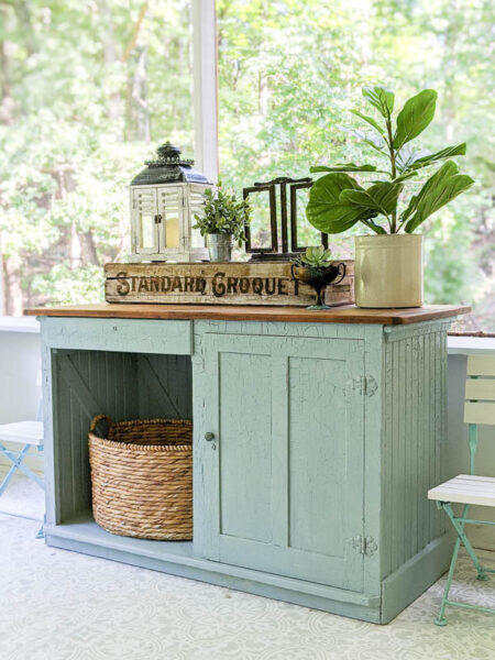 old blue cabinet painted with blue milk paint on the screened in porch
