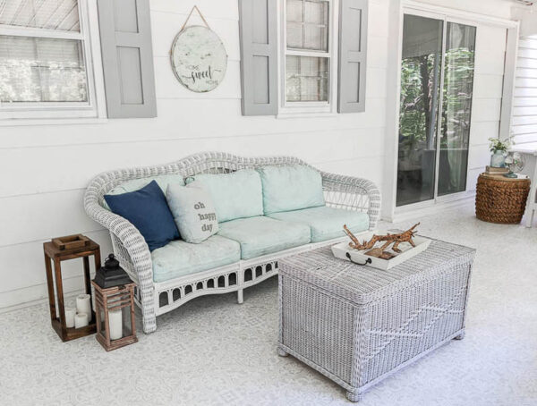 wicker outdoor sofa with the wicker painted white and the cushions painted blue