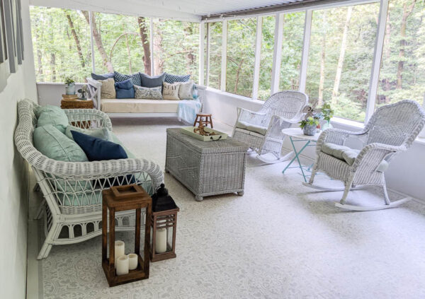 light, bright screened-in porch with gray and white stenciled floor and white walls