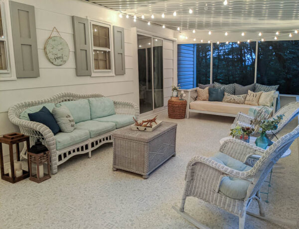 screened-in porch with white string lights