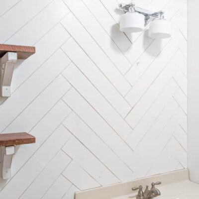 How to DIY a Herringbone Wood Wall on a Budget