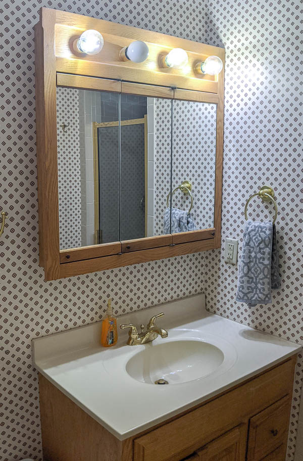 ask bathroom vanity and matching oak medicine cabinet with attached vanity light