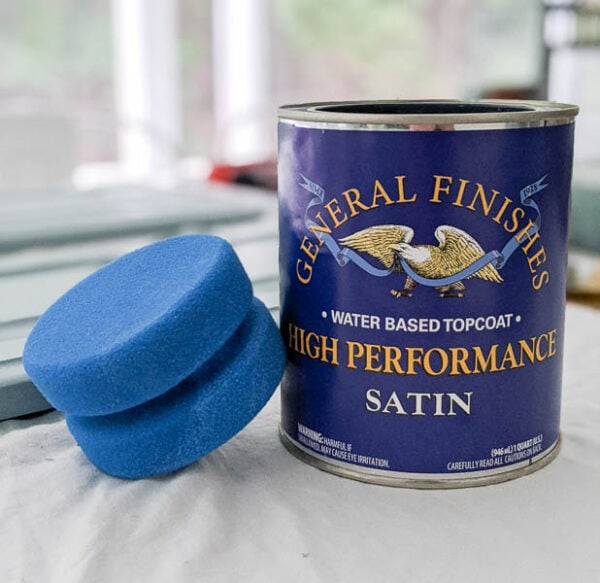 a can of General Finishes High Performance Top Coat and the blue sponge applicator from Dixie Belle paint