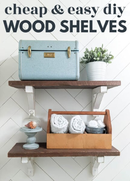 reclaimed wood bathroom shelves with diy white shelf brackets against a white herringbone wall with text: cheap and easy diy wood shelves.