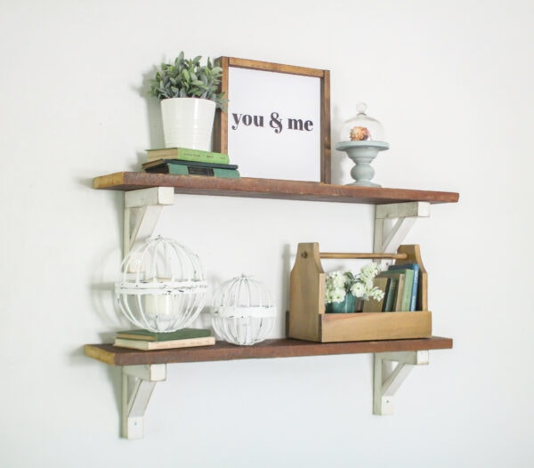 Reclaimed wood shelves with diy white shelf brackets styled with farmhouse decor.