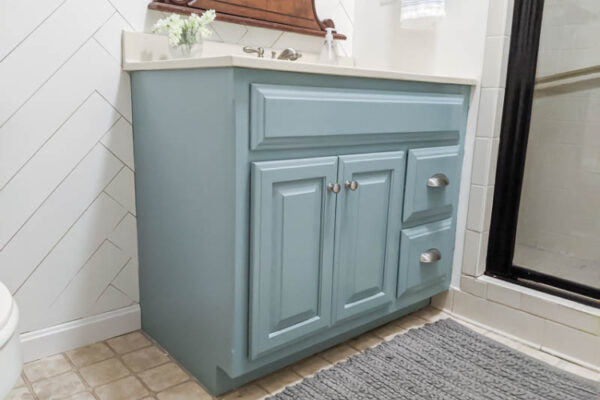 bathroom vanity painted light blue using General Finishes milk paint in Persian Blue