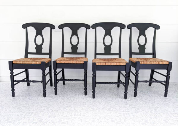 Wooden chairs with woven seats painted black