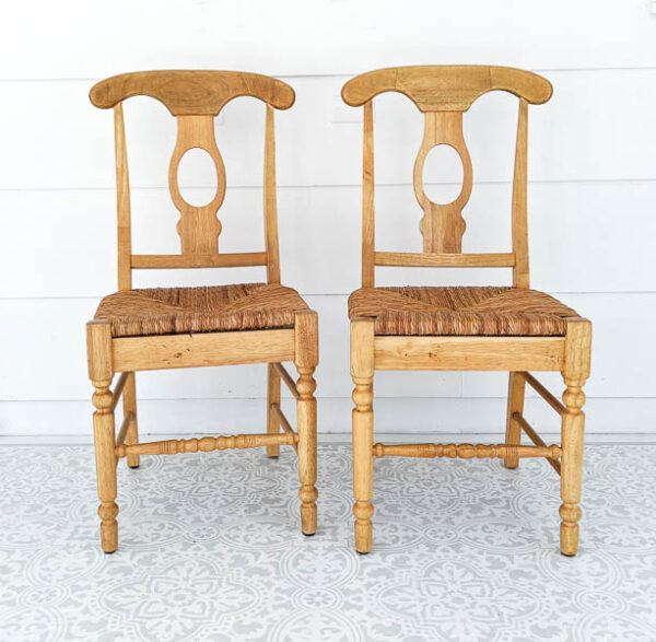 two light wood chairs with woven seats before paint