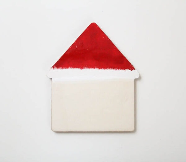 house shape with roof painted red and white like Santa's hat