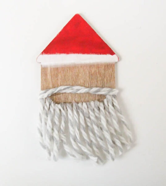 santa ornament with yarn mustache and beard.