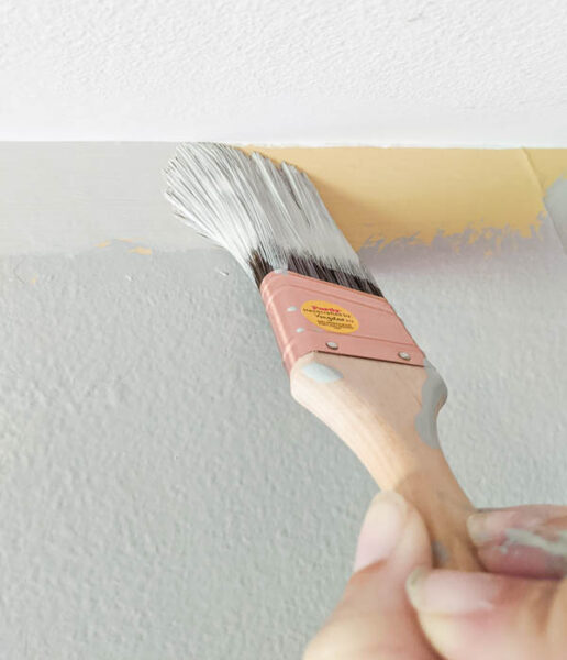 cutting in along the ceiling with an angled purdy paintbrush