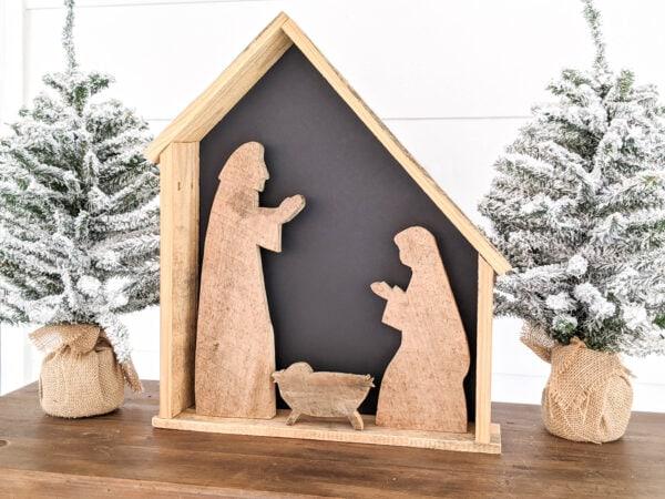 Diy wood nativity with black backing.