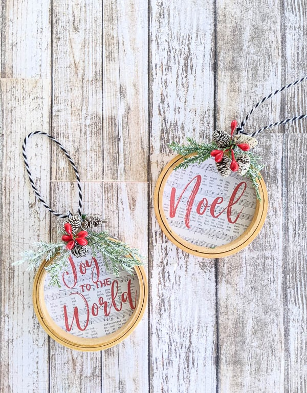 DIY embroidery hoop ornaments made using the songs Joy to the World and Noel.