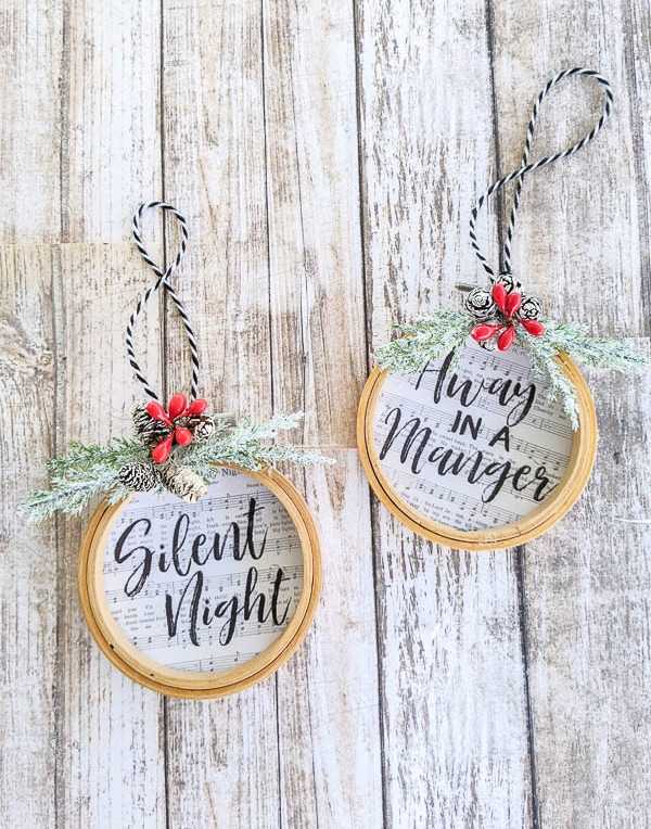 diy embroidery hoop ornaments with the songs Silent Night and Away in a Manger on them.