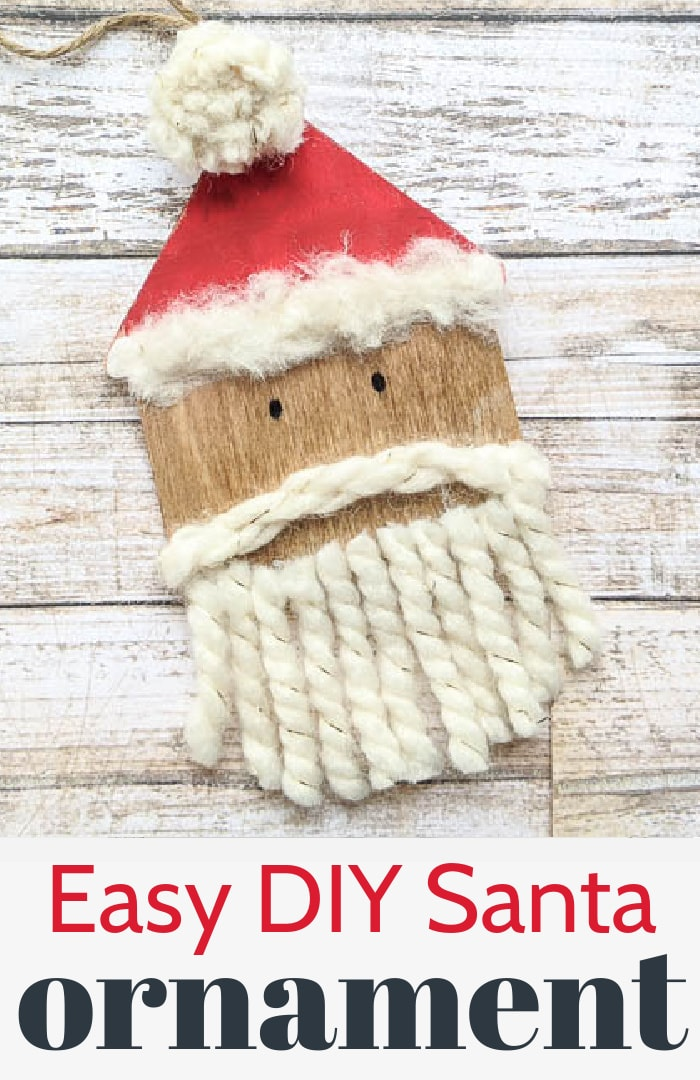 close up of wooden Santa ornament with yarn beard