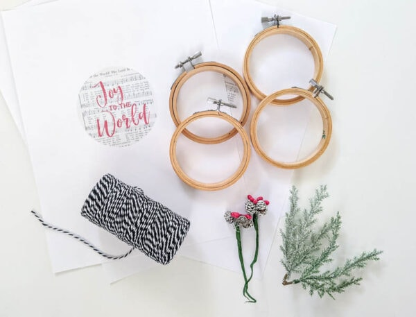 materials for ornaments - printable designs, embroidery hoops, mini pinecones, mini branches, bakers twine.