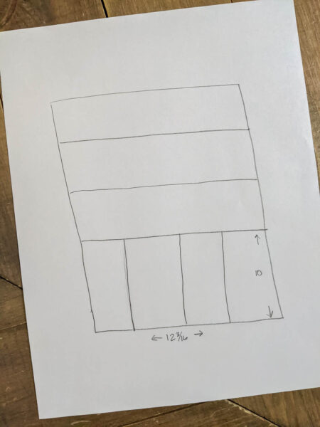 simple diagram of silverware drawer layout drawn on paper.