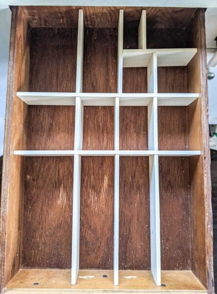 empty DIY wood drawer divider in junk drawer.