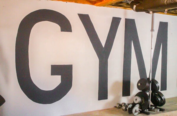 huge letters spelling gym painted on wall.