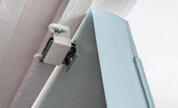 magnetic catch at top of closet doors.