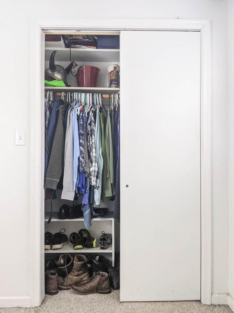 small closet with sliding closet doors with one door open