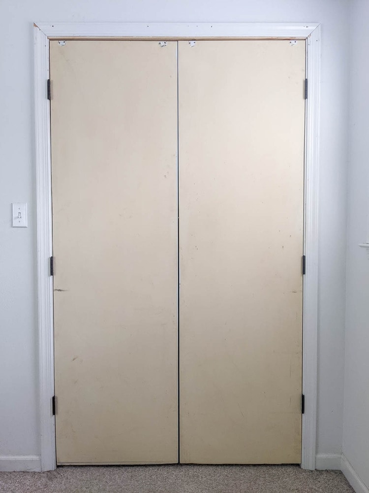 old sliding closet doors rehung with hinges.