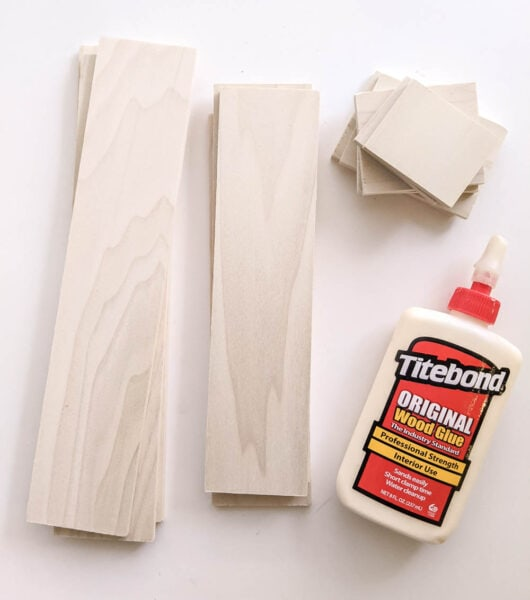 Wood glue and wood cut to size for drawer dividers.