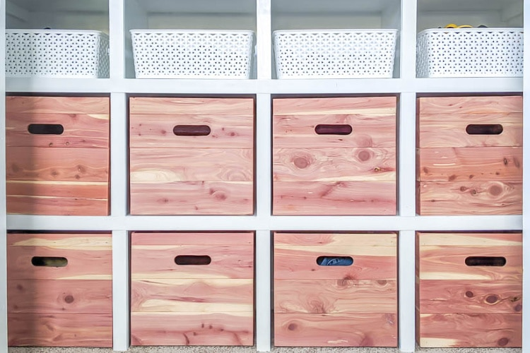 DIY closet shelves made from MDF with DIY cedar storage boxes.