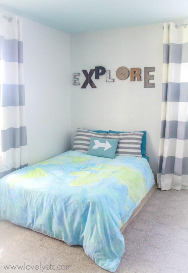 painted world map duvet cover in little boys bedroom.