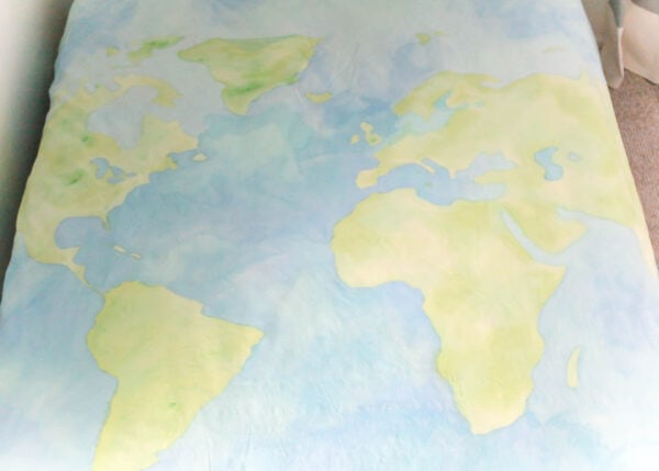world map painted on duvet cover.