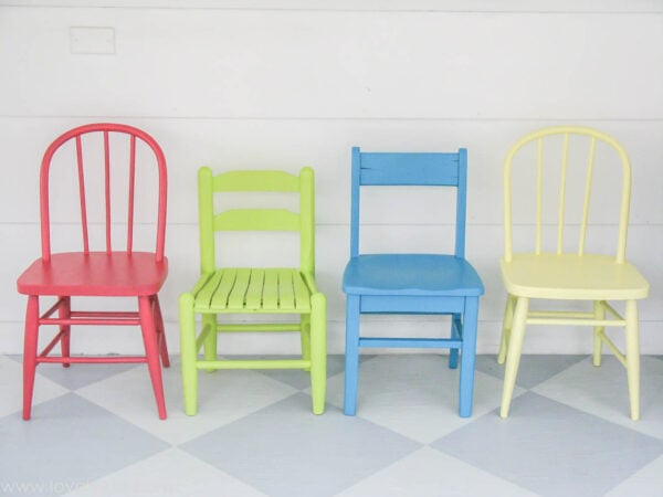vintage kids chairs painted hot pink, blue, lime green, and yellow.