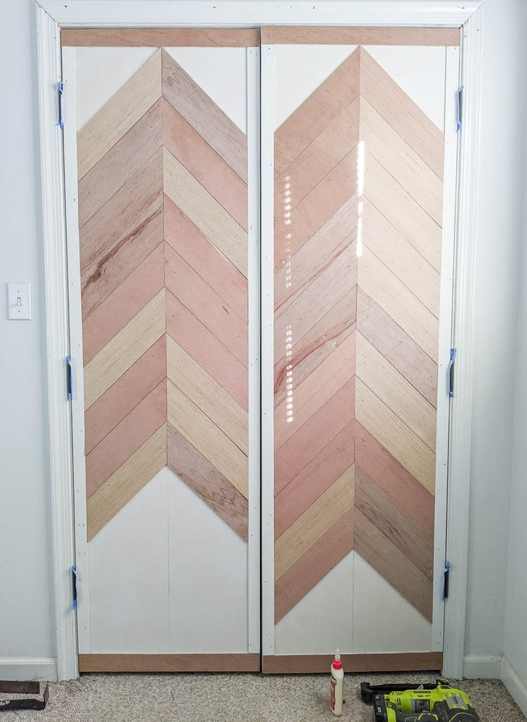 continuing the chevron wood planks down the door.