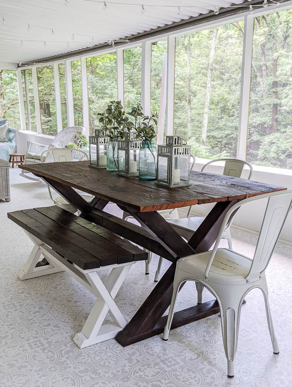 DIY wood farmhouse table and bench made from inexpensive lumber.