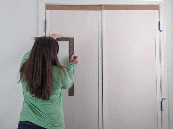 drawing a line down the center of each door.