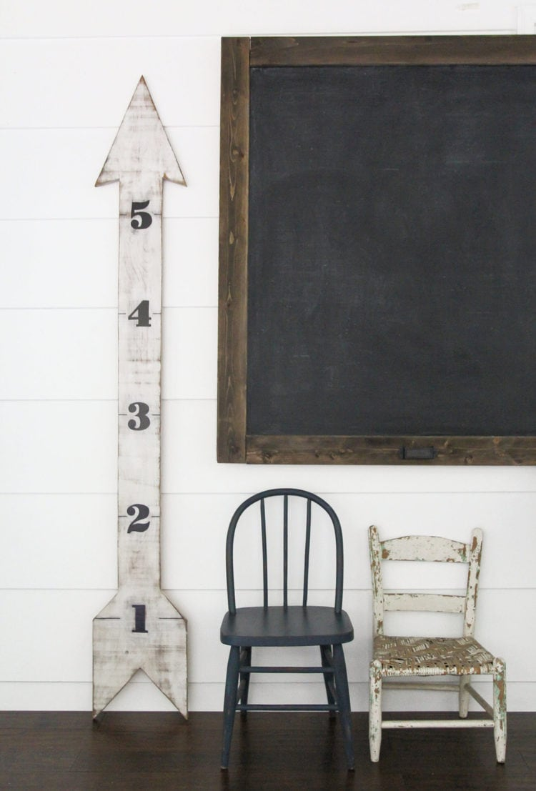 huge diy wood chalkboard, diy wooden arrow growth chart, and vintage children's chairs.