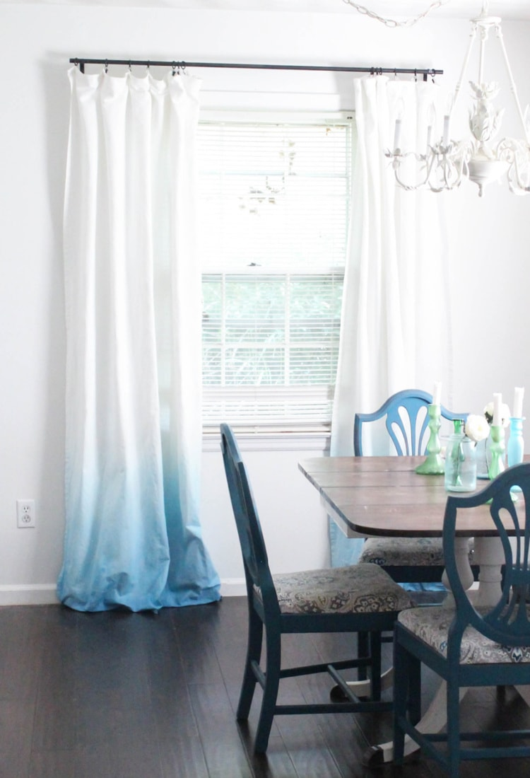 diy blue ombre curtains hanging on window in dining room.