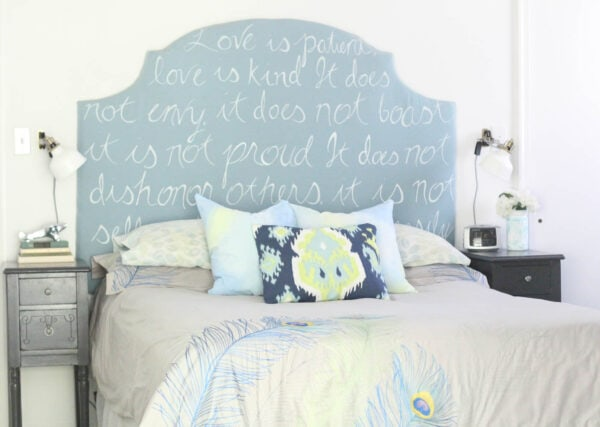 bed with diy pillow covers and diy painted upholstered headboard.