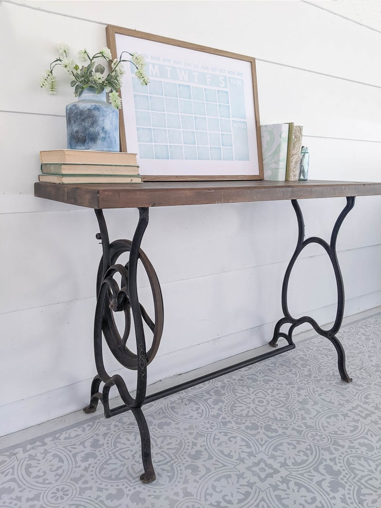 old cast iron sewing machine table legs repurposed to make a small table with an upcycled wooden top.