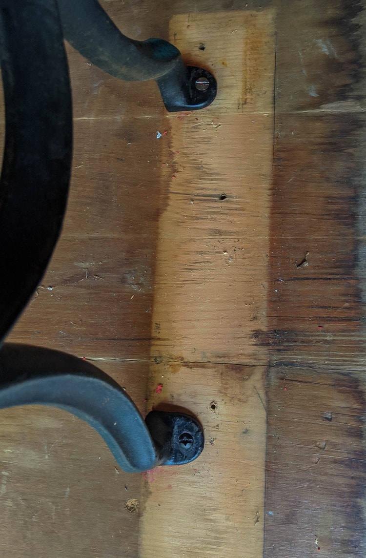 attaching sewing machine legs to wooden table top.