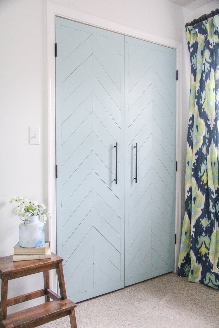 Closet doors  updated with thin plywood laid in a chevron pattern and painted.