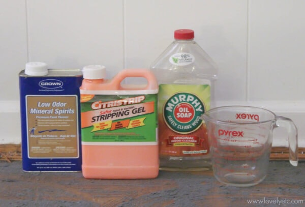 Preparing to test methods for removing glued-down carpet - Murphy's soap, mineral spirits, citristrip, and boiling water.