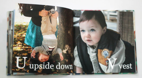 abc photo book with u for upside down and v for vest.