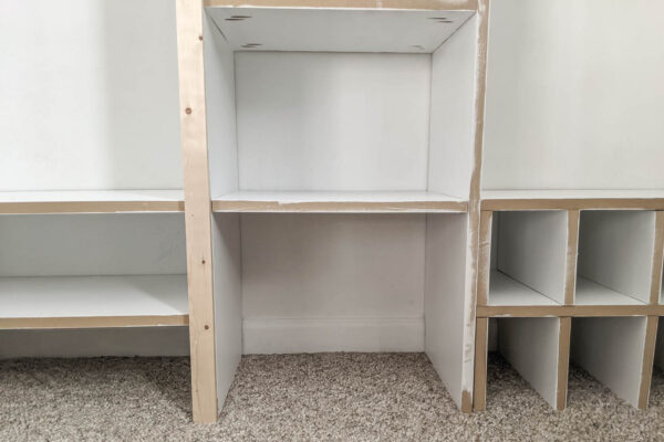 Adding trim to one side of the diy closet organizer.