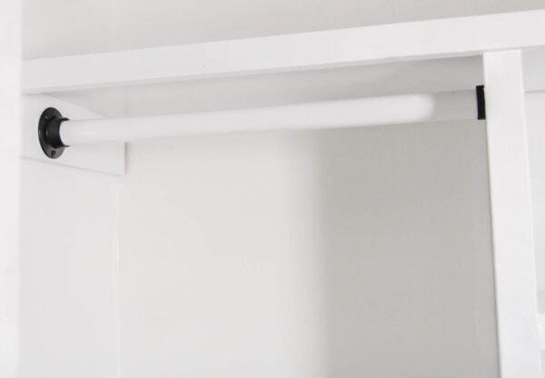 White closet rod with black closet rod sockets hanging in closet.