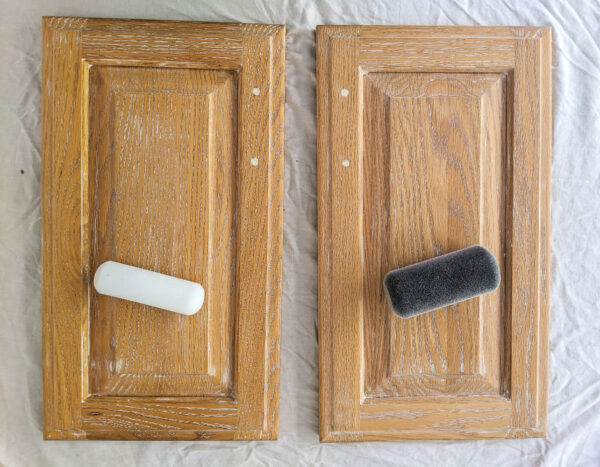 two cabinet doors with a foam paint roller and a flocked paint roller.