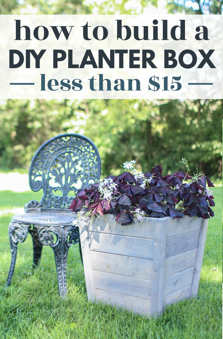 diy wooden planter box with purple shamrock next to a garden chair.