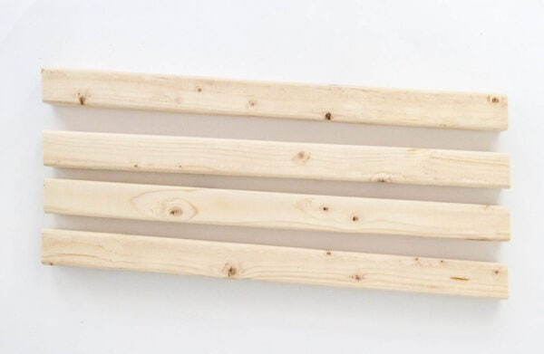 Four 2x2 pieces of wood with a five degree angle at each end to make the corners of the planter box.