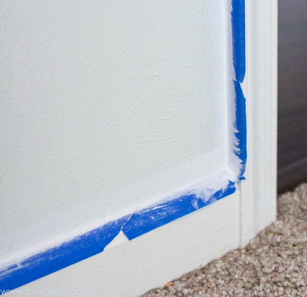 sealing over painters tape with the same color as the adjoining trim to keep any dark paint from slipping underneath and ruining the finish.